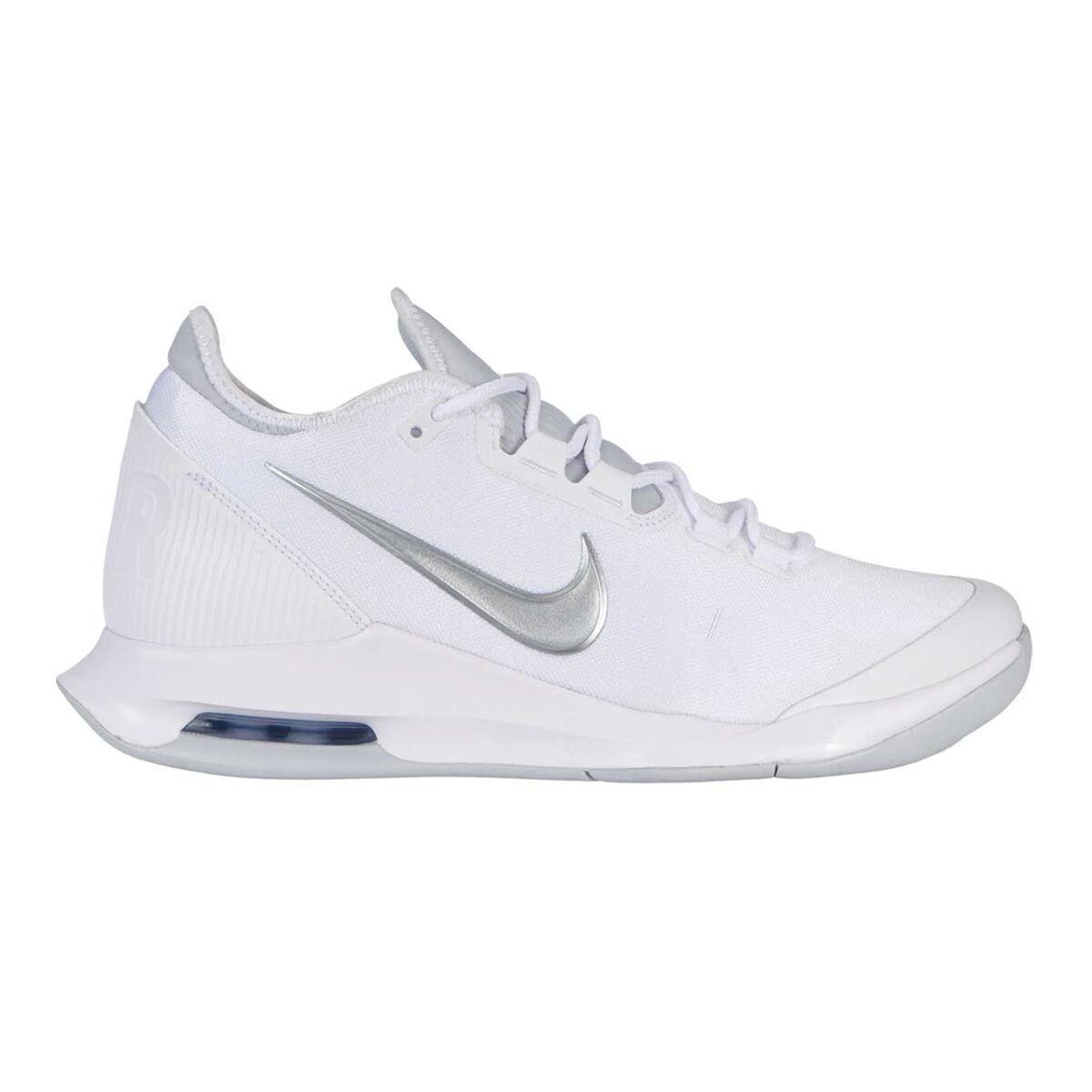 silver nike tennis shoes